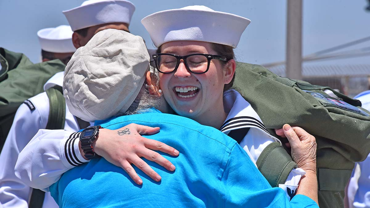 Caitlin McCarvel is all smiles as she is welcomed home by her grandmother, Delsi. Photo by Chris Stone
