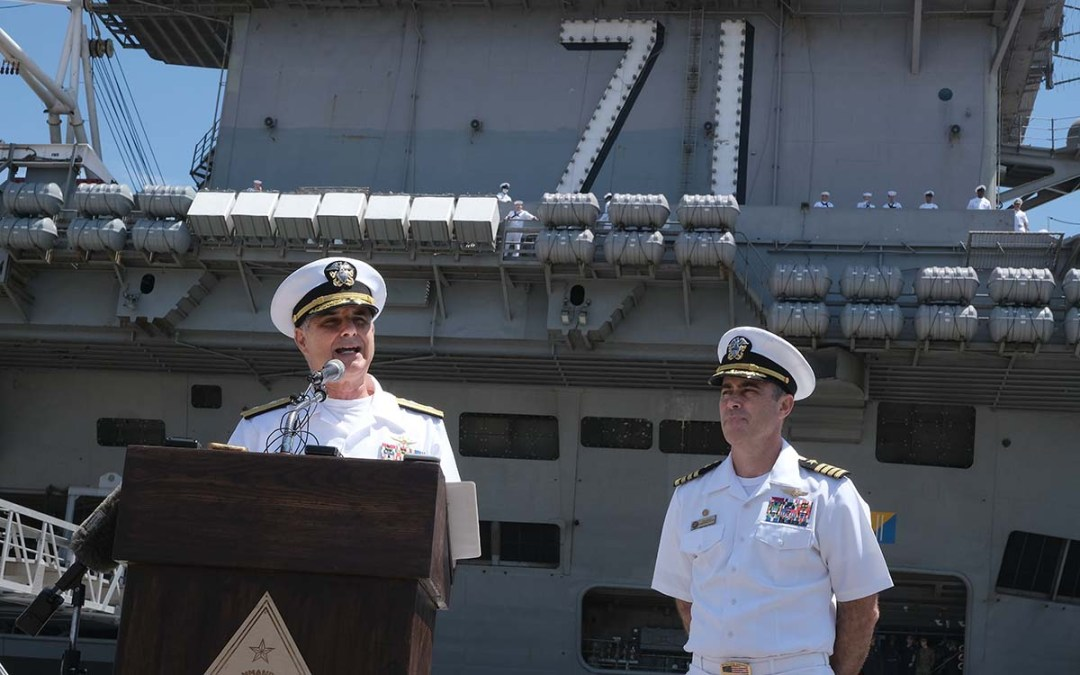 Rear Adm. Doug Verissimo, commander, Carrier Strike Group Nine (left) and Capt. Eric Anduze, commanding officer, of USS Theodore Roosevelt talk to the press. Photo by Chris Stone