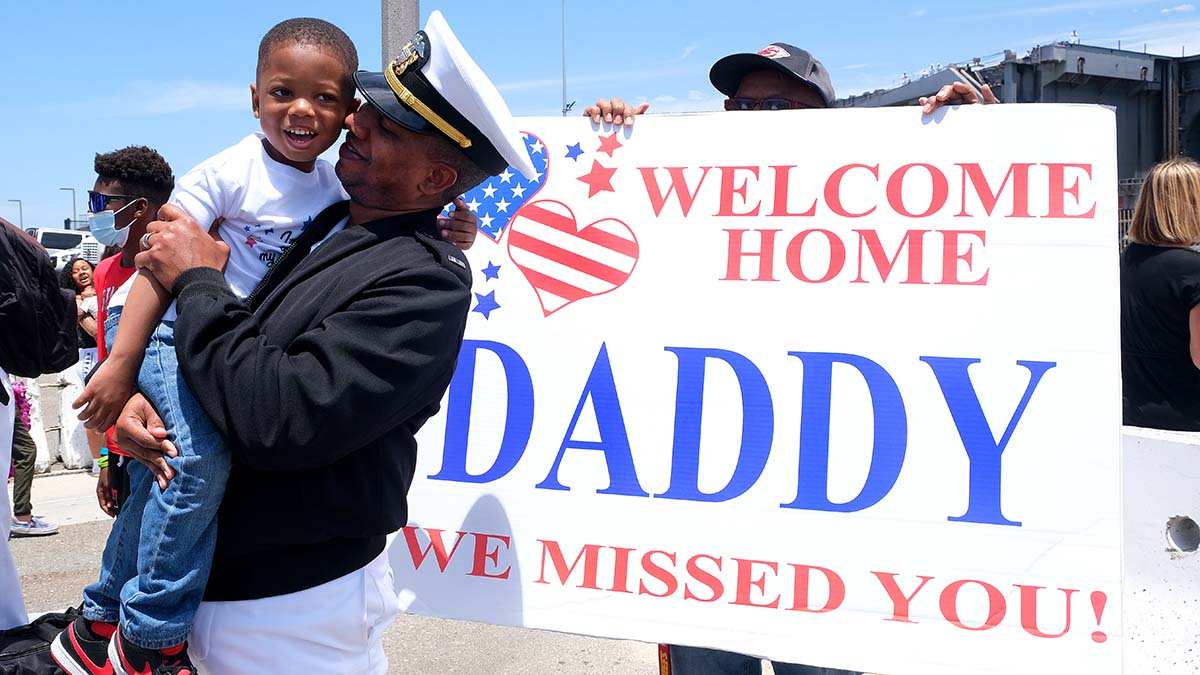 George Cannon is welcomed by his son, Langston, 4. Photo by Chris Stone