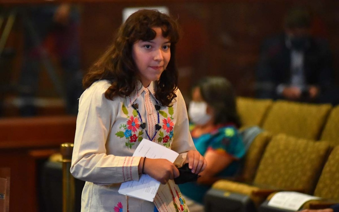 High school senior Elena Medina, heading back to her seat, was widely praised for her remarks.