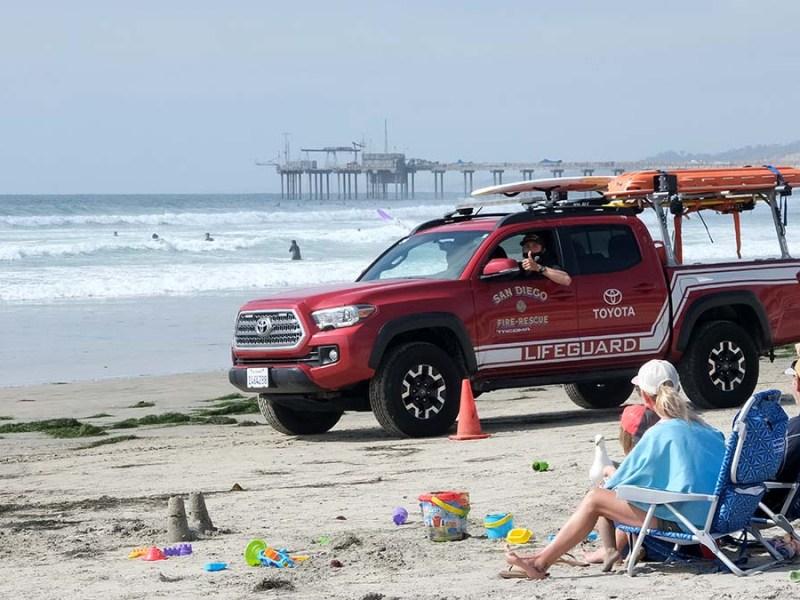 Lifeguards survey the beach at La Jolla Shores. Photo by Chris Stone