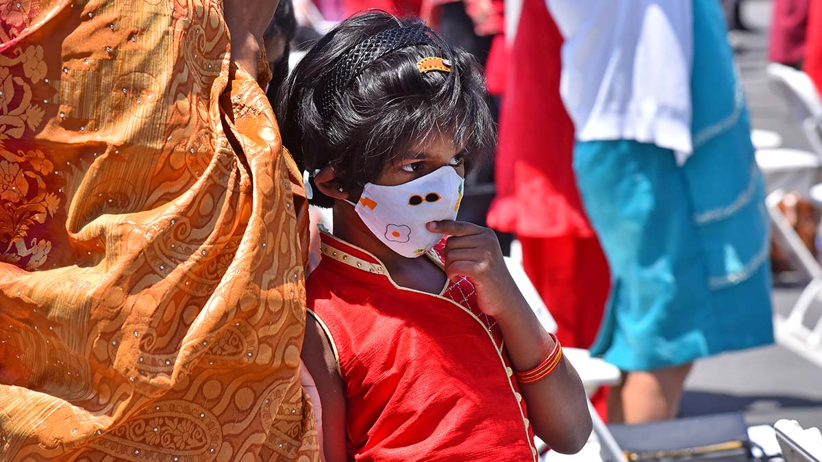 A girl of Indian descent listens to prayers during a multicultural Mass in Mira Mesa. Photo by Chris Stone