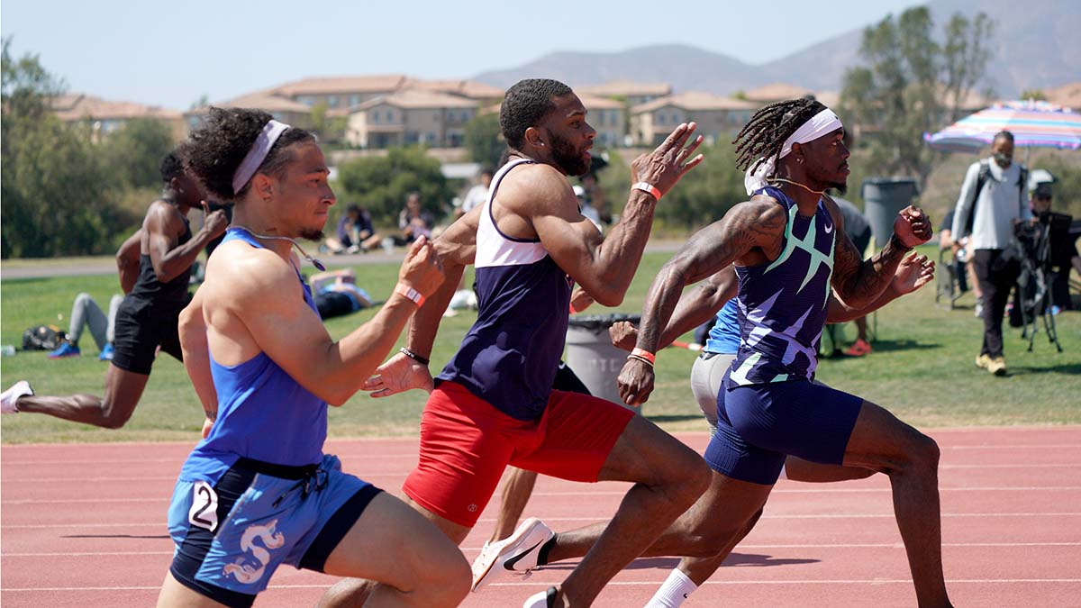 Men compete in the 100m final. Photo by Chris Stone