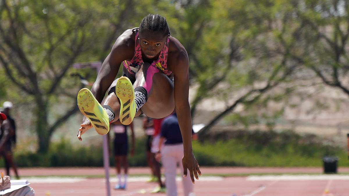 Nigerian Ese Brume won the elite long jump competition with an African record of 23-6 1/4.