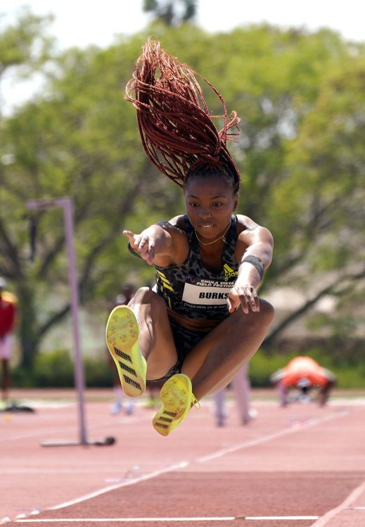 Quanesha Burks competes in the long jump. Photo by Chris Stone