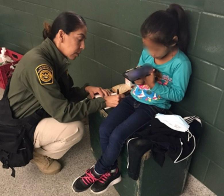 Border Patrol agent helps child