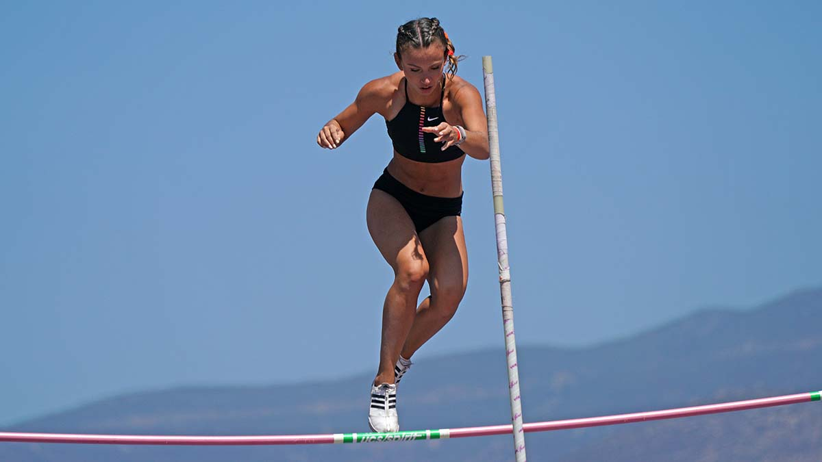 A pole vaulter watches as the pole stays on. Photo by Chris Stone