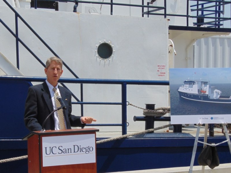 Bruce Appelgate with rendering of new ship