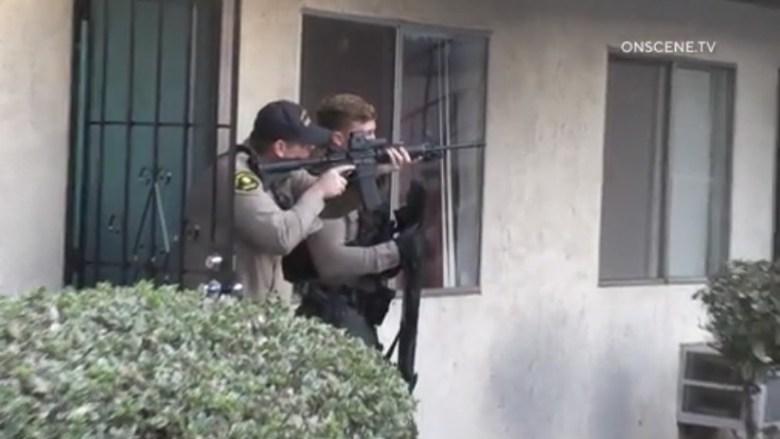 Deputies aim guns