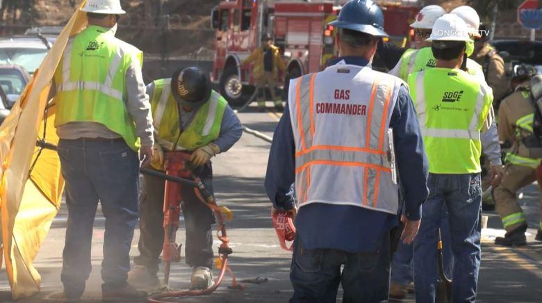 Utility crew repairs gas leak