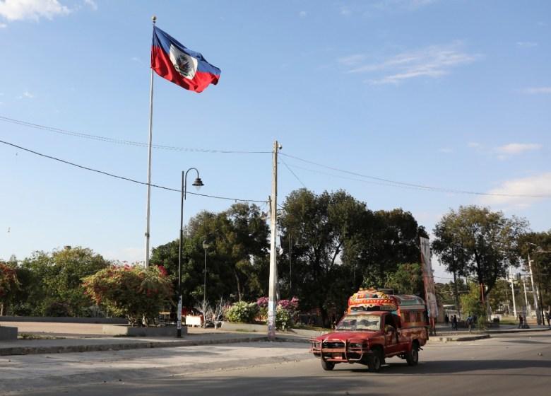 Jitney and flag in Haiti