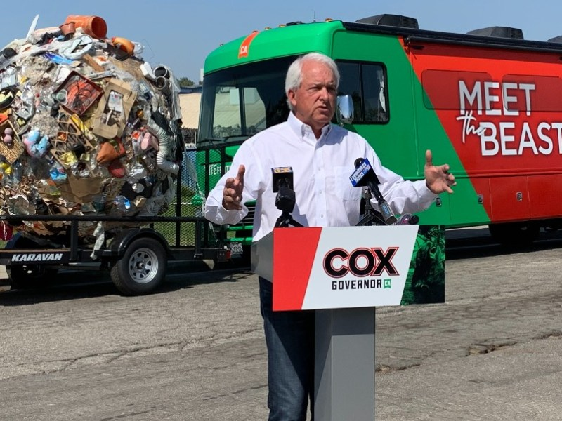 John Cox with ball of trash