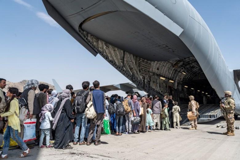 Afghan refugees board plane