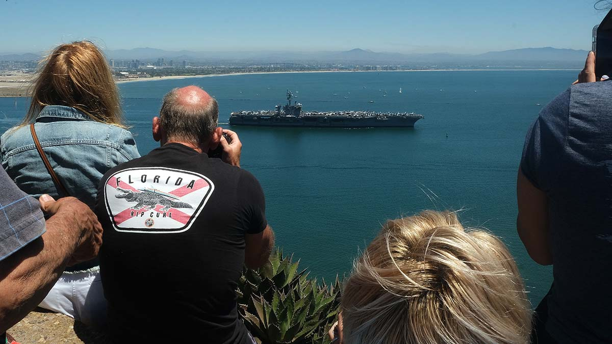 Family members gather at Cabrillo National Monument to see the sailor off on their deployment. Photo by Chris Stone