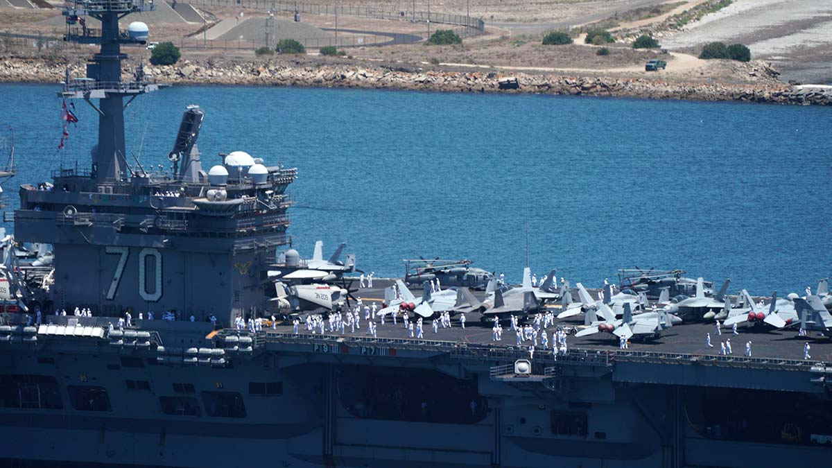 The F-35 Lightning II and Navy CMV-22B Osprey are among the aircraft on the USS Carl Vinson. Photo by Chris Stone