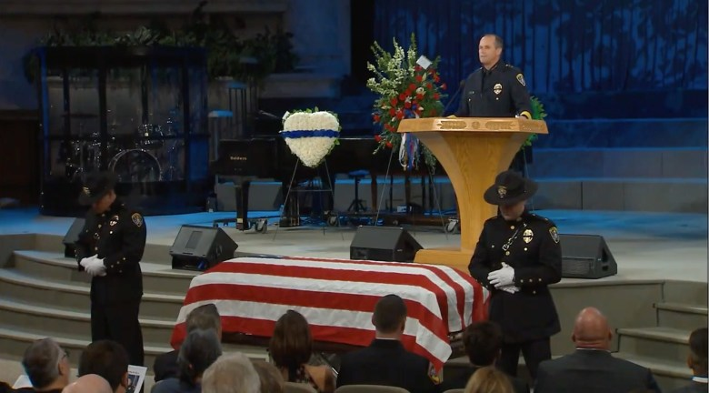 San Diego Police Chief David Nisleit speaks at the funeral for Dan Walters, a police officer and former San Diego Padres catcher. Image from Facebook