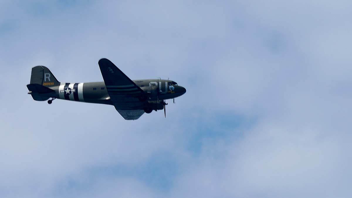 Commemorative Air Force's C-53D D-Day Doll carries Tom Rice to the correct altitude for jumping. Photo by Chris Stone