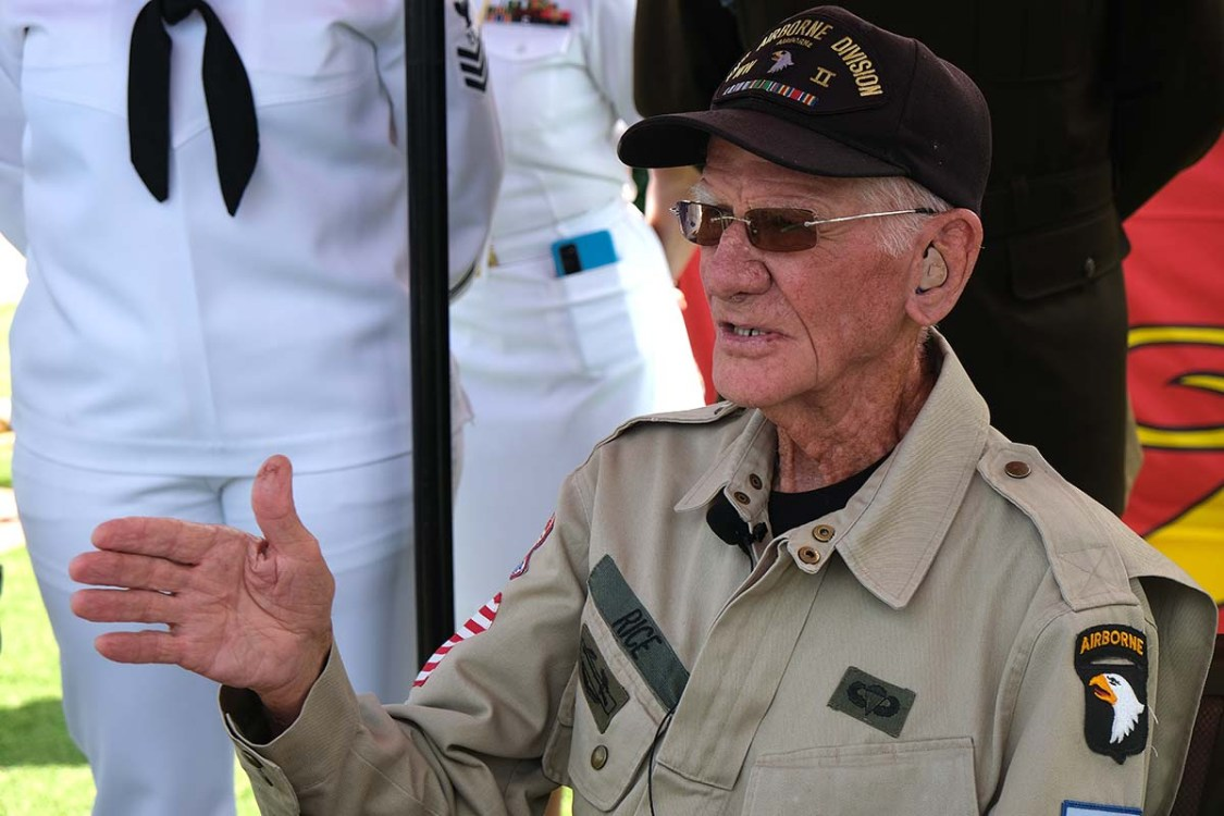 WWII veteran Tom Rice speaks with the media after his jump on his 100th birthday. Photo by Chris Stone