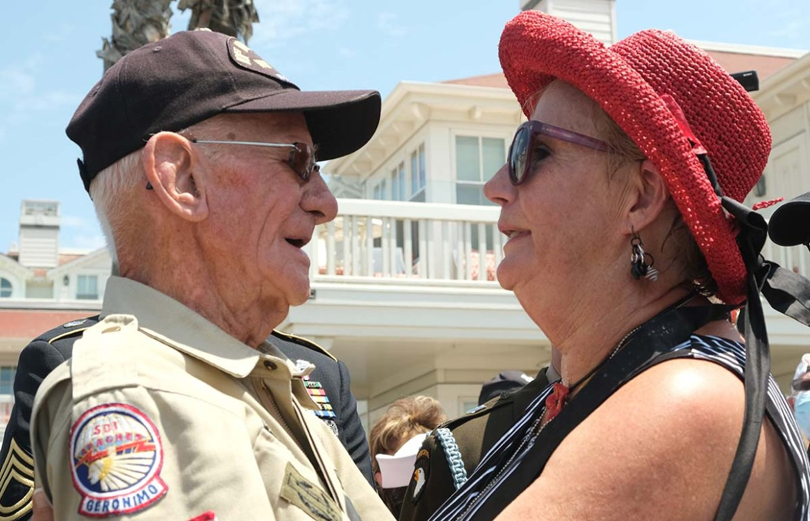 Tom Rice's wife, Brenda, welcomes him back with a hug. Photo by Chris Stone