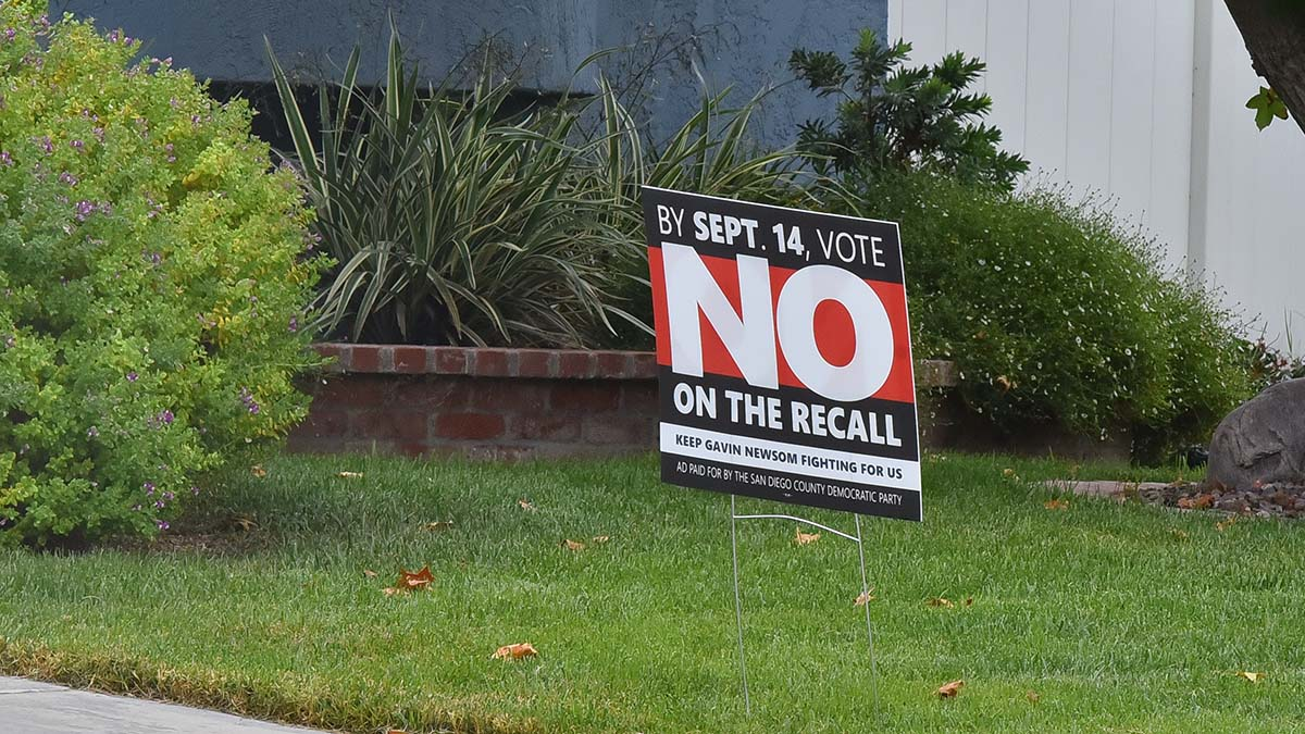 Resident displays a No on the Recall sign. Photo by Chris Stone