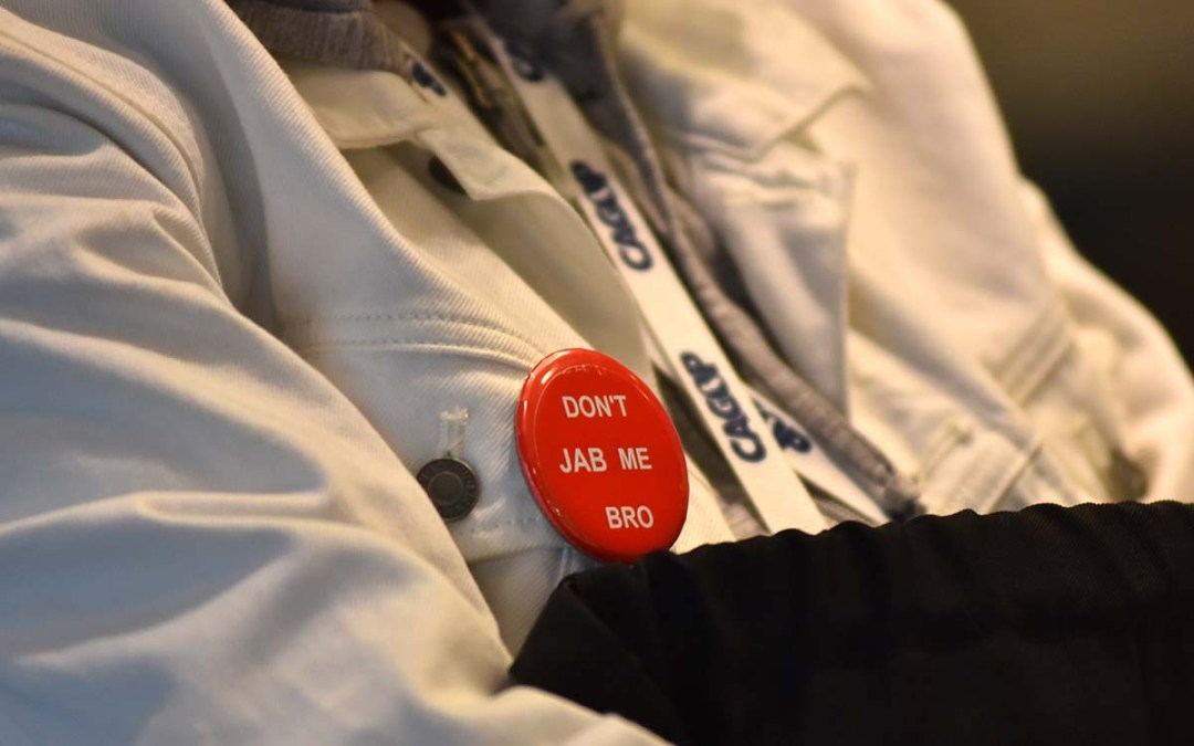 Pins at state GOP fall convention mock vaccination.