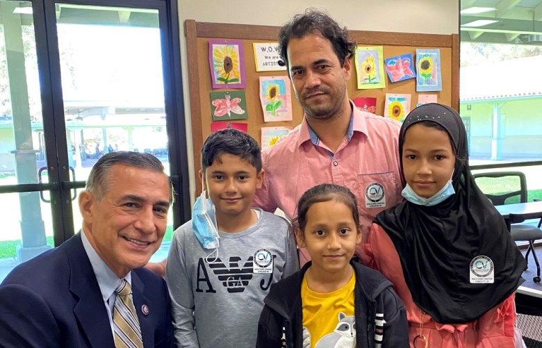 Rep. Dattell Issa with a rescued family