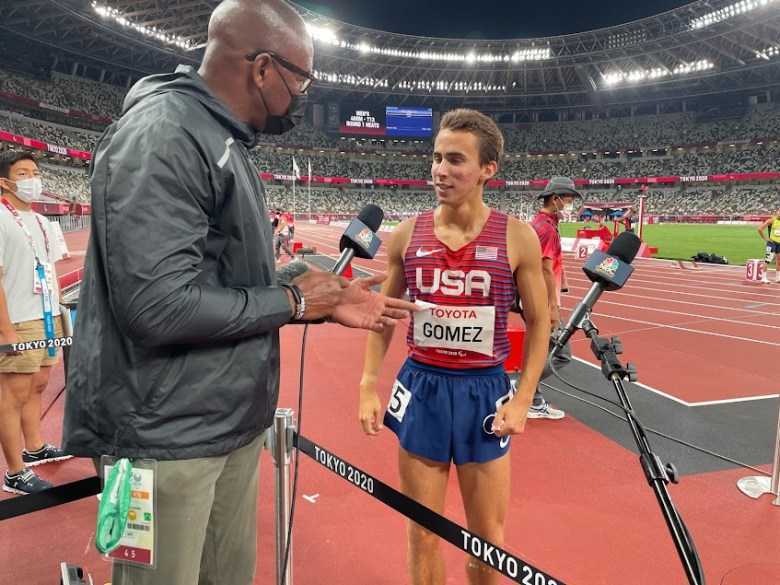 Joel Gomez chats with NBC's Lewis Johnson after 400-meter semifinal at Tokyo's Olympic Stadium.