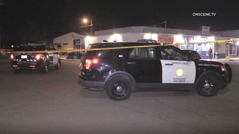 Police vehicles outside liquor store