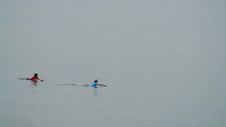 Alyssa Spencer of Encinitas (left) and Tatiana Weston-Webb face a waveless horizon. Photo by Chris Stone