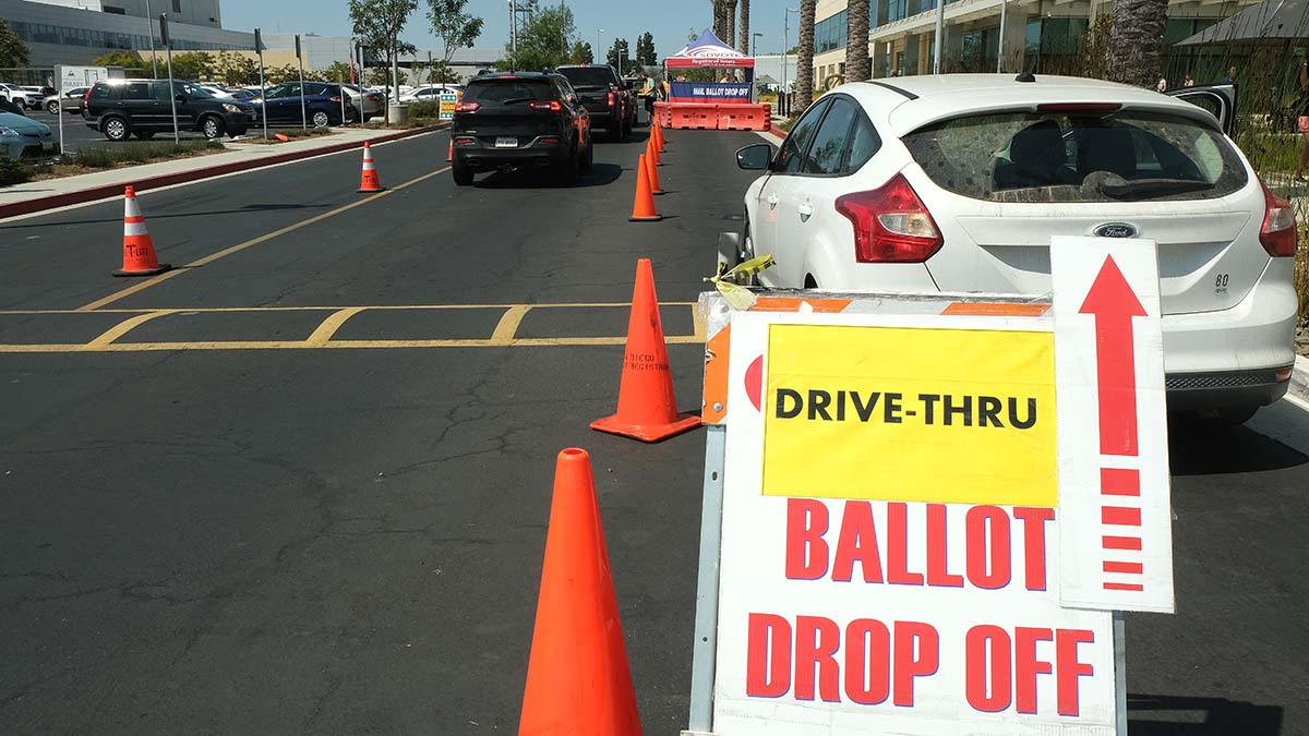 Many people dropped off their ballots at the country Registrar of Voters office. Photo by Chris Stone