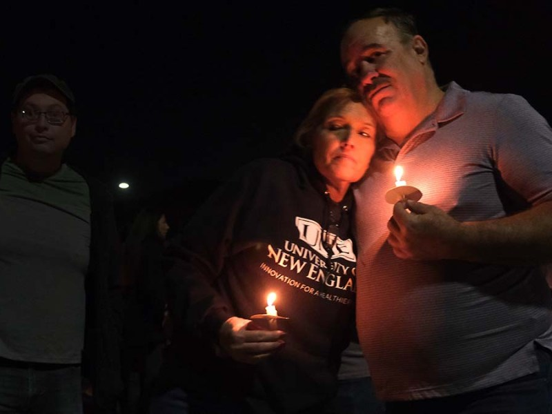 A couple attend the vigil for Steve Krueger, a UPS driver who died in a plane crash. Photo by Chris Stone