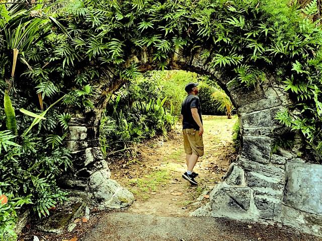 Liran walks through a moongate in Bermuda.