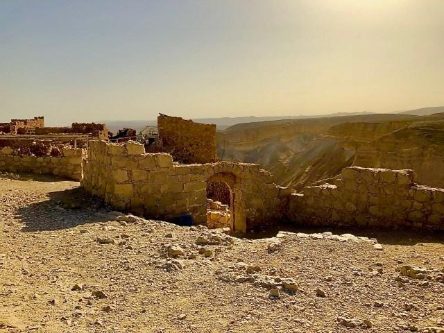 Ruins at Masada near the edge of a cliff.