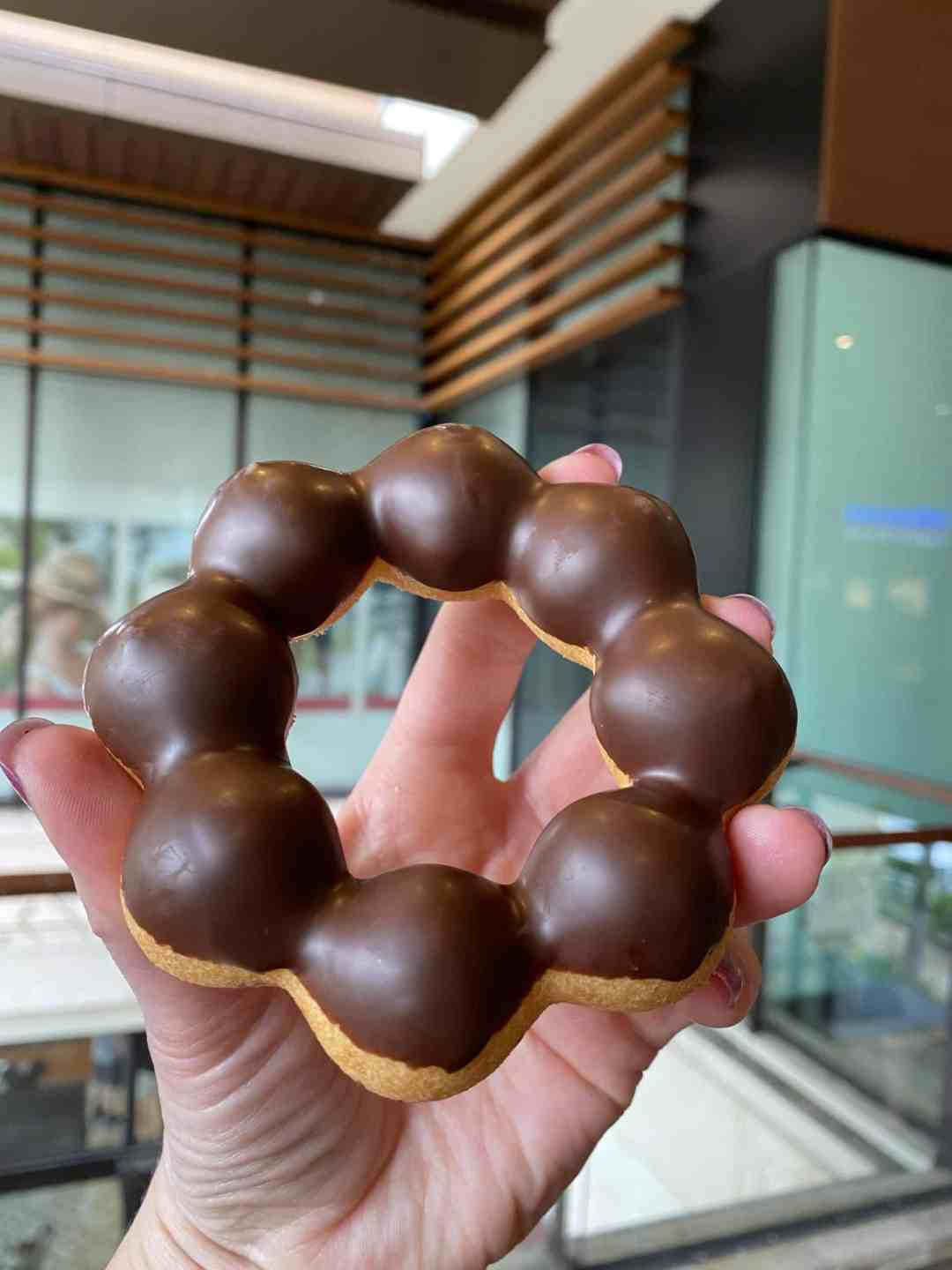 Chocolate covered ring shaped mochi doughnut
