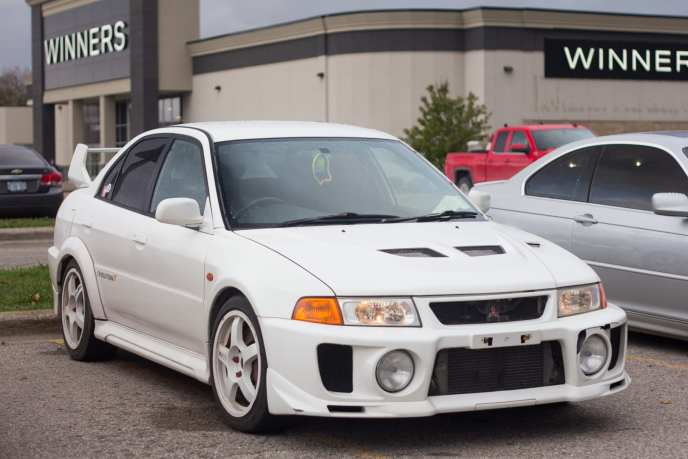 JDM Mitsubishi Lancer EVO V in white front three quarter