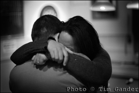 a couple hug in an english pub