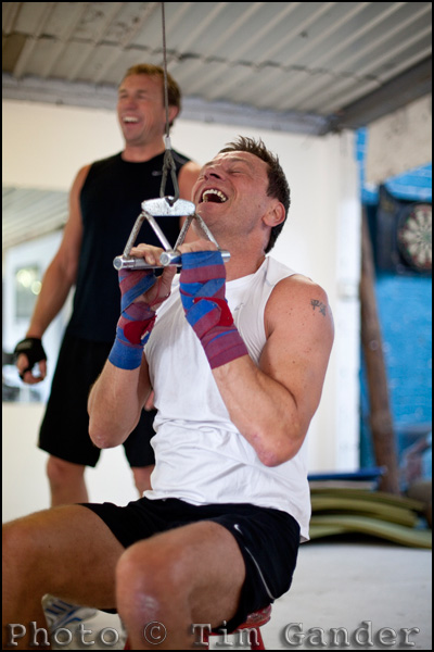 Company director Allan Meek training in the gym with Neil Munn (background)