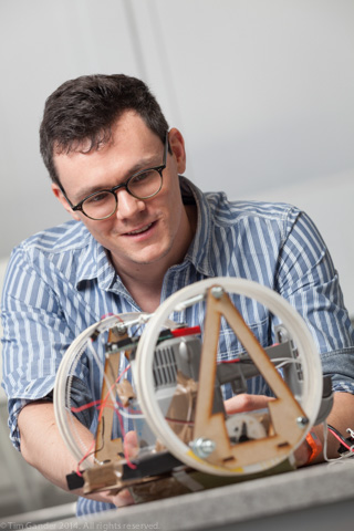 Mechanical Engineering student Robert Ford of University of Bath works on his design for a vertical climbing robot