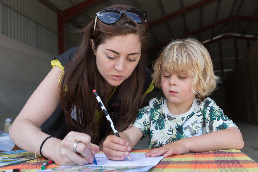 07/06/2015 Hosted at Meadowlea Farm in Compton Durville, Somerset, ABP Food Group staff get stuck in with Open Farm Sunday to help members of the public understand where their food comes from and how it's produced. Robyn Smyth of ABP helps young visitor Tom with a bit of colouring in. © Tim Gander 2015. All rights reserved.