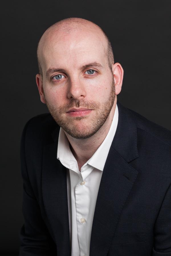 Headshot of Matt Leipnik of Digital Catapult, London non-smiling, against black.