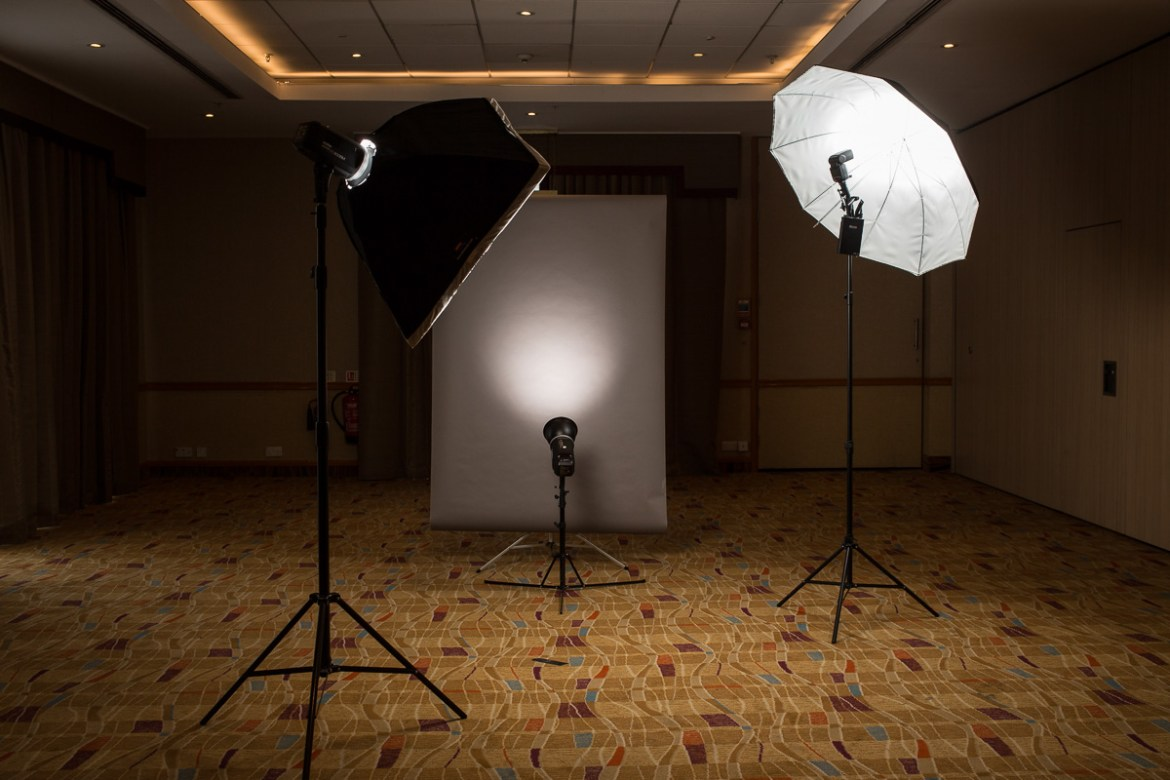 A photographer's backdrop and studio flash equipment are set up in a large empty room in the Hilton, Walcot Street, Bath, UK