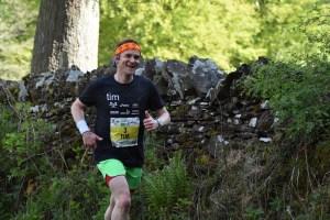 Tim running in country lane