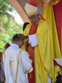 2016.08.Bishop do Nascimento lays his hands on Fr Side