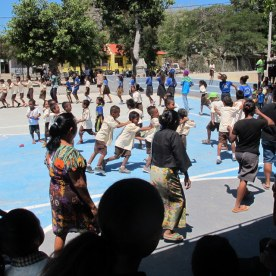 During a lull in activities, the group broke into a traditional circle dance, with younger kids making up an inner circle. In the noonday heat, I politely declined and held my place in the shade.