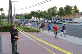 A county sheriff deputy watches near the park