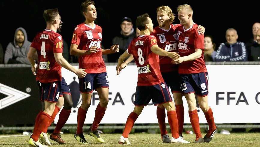 Adelaide United attempt to play out past Newcastle Jets' pressing