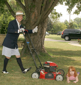 comical picture of Tim purshing a lawn mower over a red headed child
