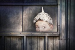 bigstock paranoia boy in tin hat