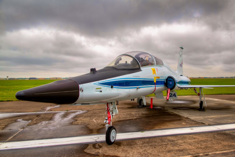 The T-38 is the model plane that you always saw escort the shuttle each time is returned to earth. In Houston, we saw many of the astronauts return to Ellington Field after their missions too. It's a plane that isn't large, but looks like it would be a lot of fun to fly. I'm available if anyone takes one up soon. Photo by Tim Stanley Photography.