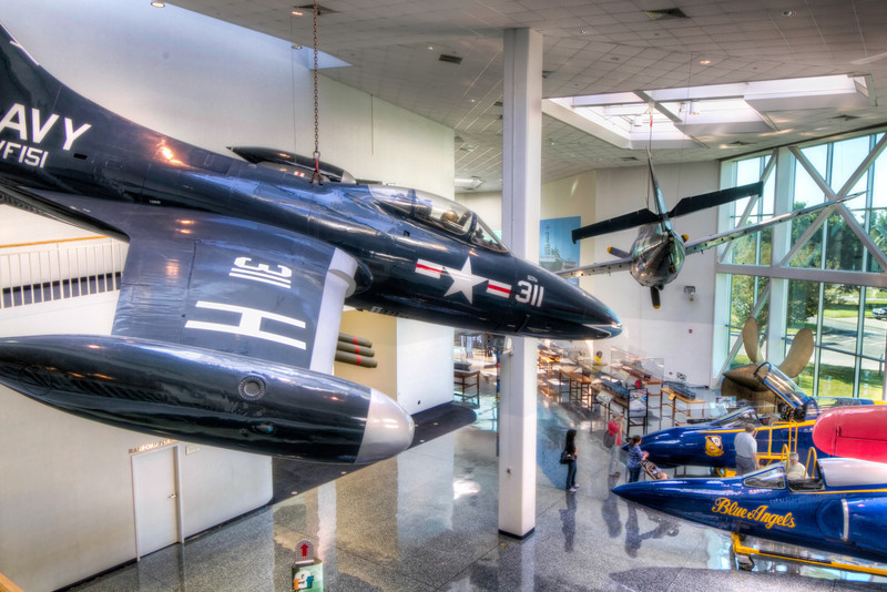 Wearing the colors of its old squadron, VF-151, and the Bureau Number 123050, this F9F-2 Panther is one of five showpiece aircraft suspended in the Quarterdeck at the National Museum of Naval Aviation. Photo by Tim Stanley Photography.